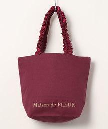 Maison de FLEUR(メゾンドフルール)の帆布フリルハンドルトートMバッグ(トートバッグ)