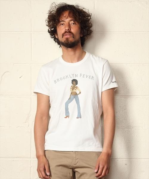 TMT(ティーエムティー)の「【TBSドラマ「凪のお暇」着用】S/SL GAUZE STRETCH JERSEY(AFRO GIRL)(Tシャツ/カットソー)」|ホワイト