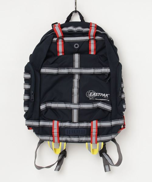 WHITE MOUNTAINEERING(ホワイトマウンテニアリング)の「【WHITE MOUNTAINEERING × EASTPAK】ホワイトマウンテニアリング REFLECTIVE TAPED BIG BACKPACK(バックパック/リュック)」|ネイビー