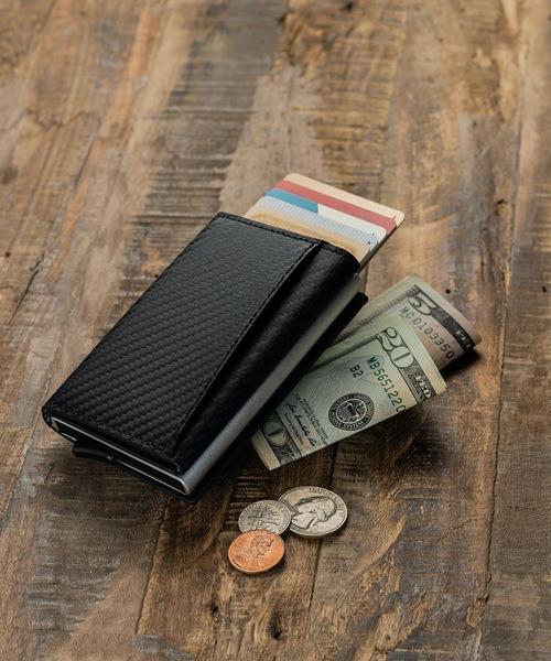 MURA(ムラ)の「RFIDスキミング防止機能付 レザー カーボン 三つ折り ミニ財布(財布)」 ブラック系その他