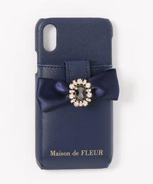 9f4821a37ec0 Maison de FLEUR(メゾンドフルール)の「・ビジューリボンポケットアイフォンX/