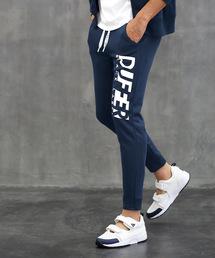 The DUFFER of ST.GEORGE(ザダファーオブセントジョージ)の〔BLACK LABEL〕COOLMAX SIDE LOGO SW PANTS:クールマックス スキニースウェットパンツ(パンツ)