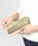 tsumori chisato CARRY(ツモリチサトキャリー)の「シュリンクコンビ 長財布(財布)」|ゴールド