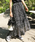 AZUL ENCANTO(アズールエンカント)の「【手洗いできる】【消臭効果】プリント柄ランダムプリーツフレアスカート(スカート)」|ブラック
